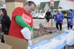 May 11, 2013 CHICAGO - Tommy Reynolds, of Roscoe Village, prepares water for the runners of the Race to Wrigley 5K. Reynolds has volunteered at the event since the first one was held.